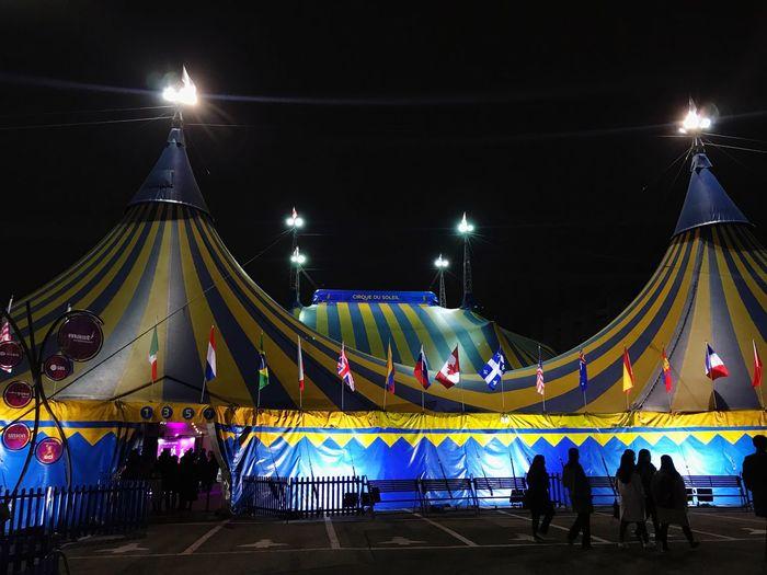 Kooja Circus Tent Night Illuminated Flag Multi Colored Travel Destinations Arts Culture And Entertainment