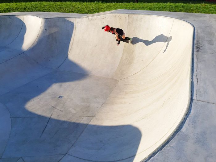 High angle view of woman skateboarding at park