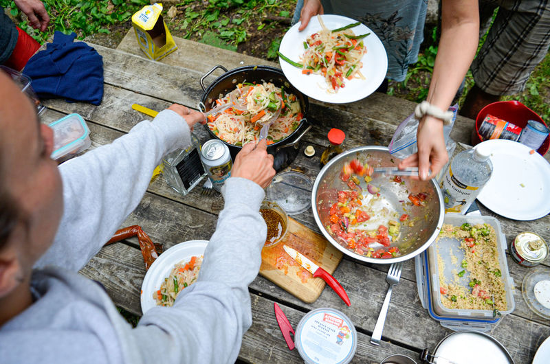 Human Hand Camping Stove Teamwork Togetherness Friendship Eating Plate Domestic Life Men Young Women Prepared Food Grilled