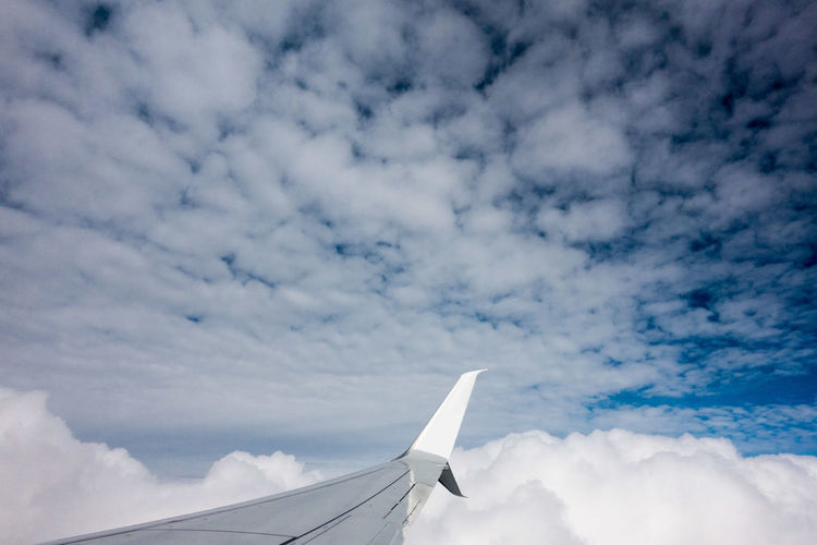 Air Vehicle Airplane Airplane Wing Beauty In Nature Blue Cloud - Sky Day Flying Journey Nature No People Outdoors Scenics Sky Transportation