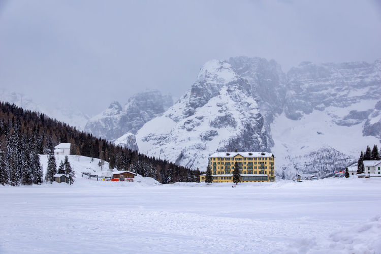 Architecture Beauty In Nature Building Exterior Built Structure Cold Temperature Day Frozen Landscape Misurina Lake Mountain Mountain Range Nature No People Outdoors Scenics Sky Snow Snowcapped Mountain Snowing Tranquil Scene Tranquility Transportation Weather White Color Winter