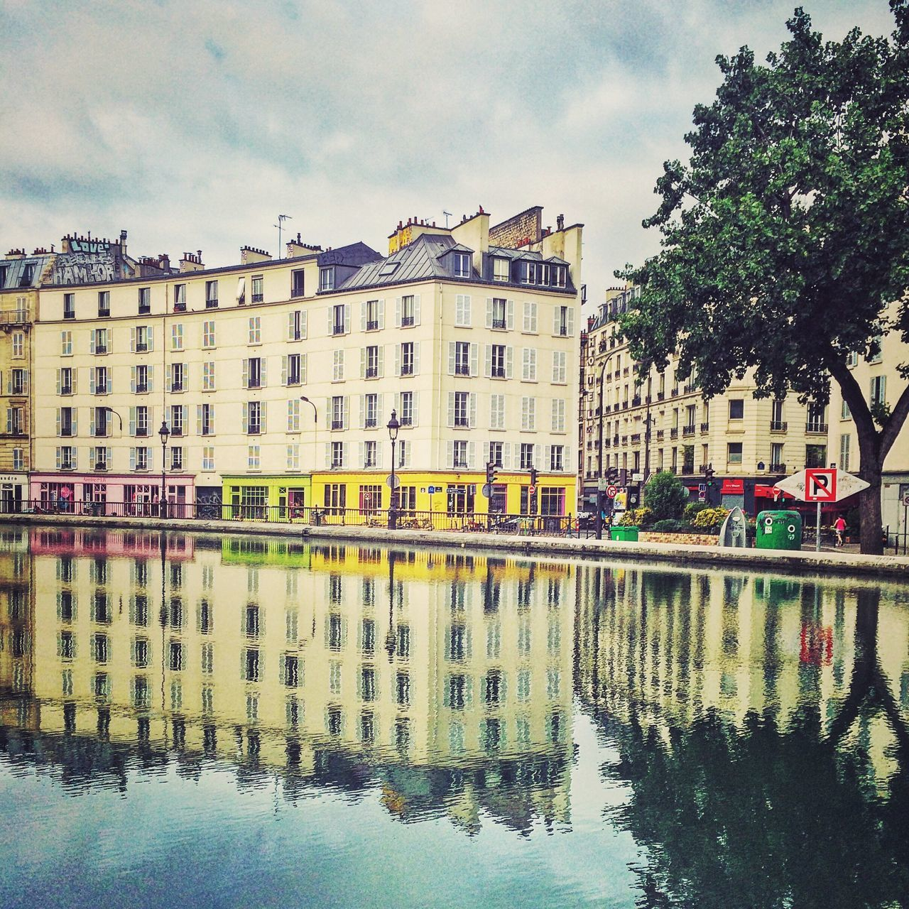Canal saint-martin against buildings in city