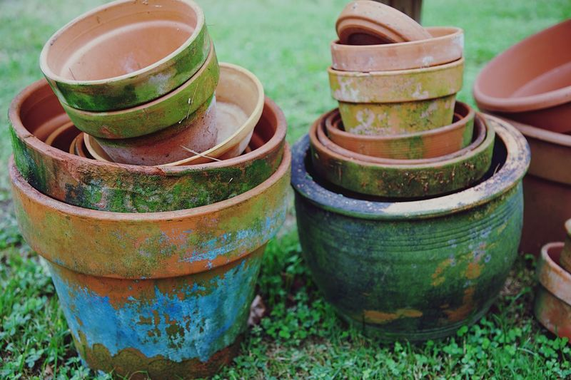 Planters Stack Day No People Plant Container Nature High Angle View Focus On Foreground Close-up Art And Craft Still Life Outdoors Pottery Green Color Ceramics Grass Old Growth Craft Group Of Objects