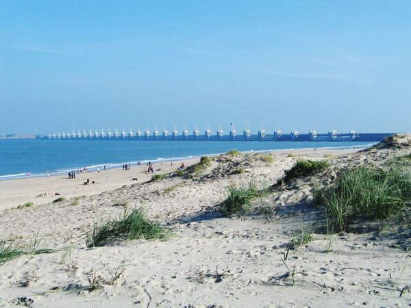 Sea Water Beach Sky Nature Horizon Over Water Scenics Beauty In Nature Outdoors Sand Netherlands Tower Beachphotography Nature Nature_collection EyeEm Nature Lover Winter Wintertime Blue Sky Blue Day Tranquility Tranquil Scene Architecture People