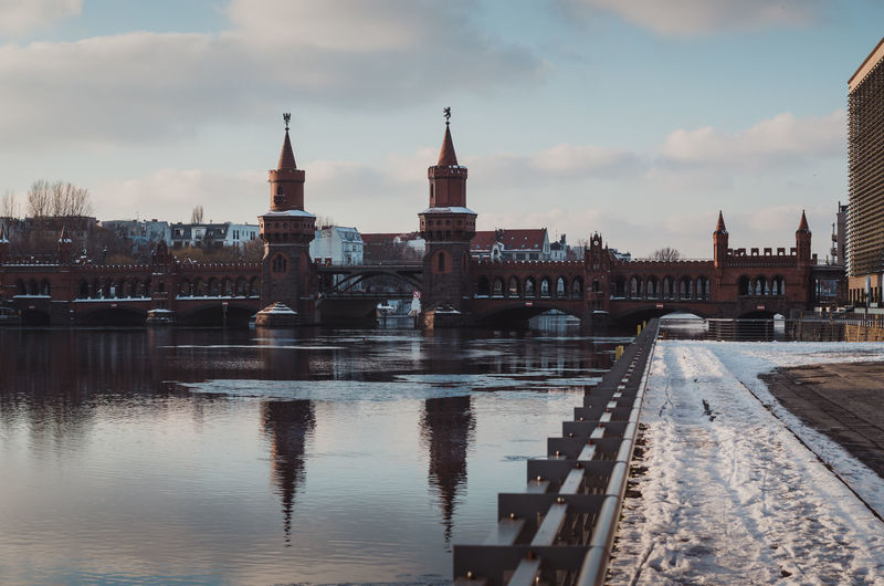 Oberbaumbridge in Berlin during the winter season Architecture Berlin Bridge City Cityscape Connection Day Friedrichshain Ice On The Water Kreuzberg No People Oberbaumbridge Oberbaumbrücke Outdoors Sky Spree River Berlin Travel Destinations Urban Skyline Water Winter Winterscapes Wintertime