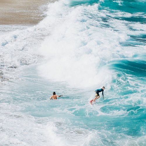 People surfing in sea