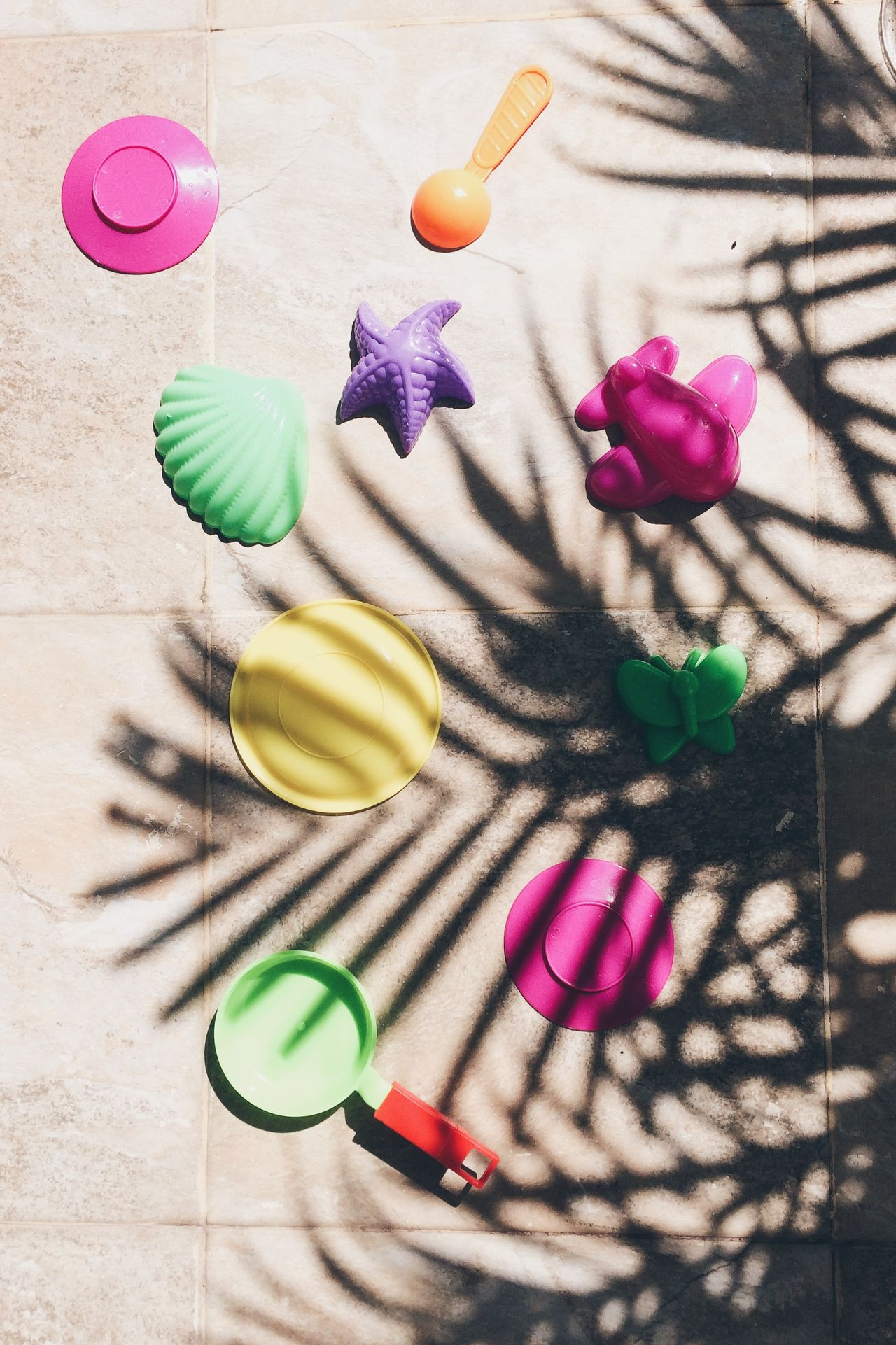 High angle view of plastic toys on floor during sunny day