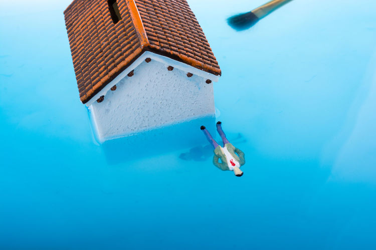 High Angle View Of Figurine With House In Water