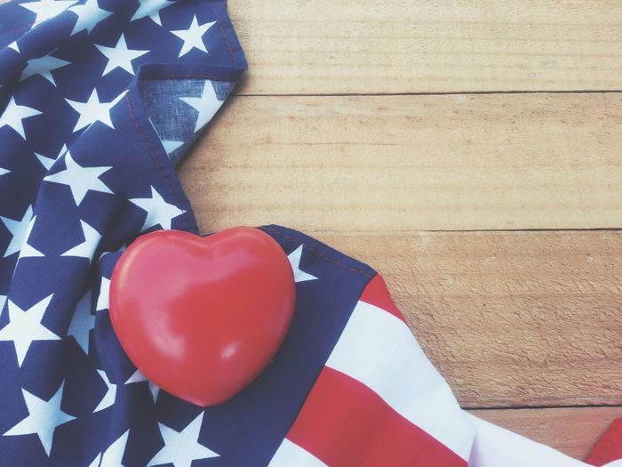 Red heart and american flog on old wood table Red Flag Patriotism Independence Anniversary 4th Of July Memorial Patriotism Memorial Day Event USA America Nation Country Pride Peace Peaceful Holiday Memory Soldier Army Celebrate Greeting Cheerful Liberty