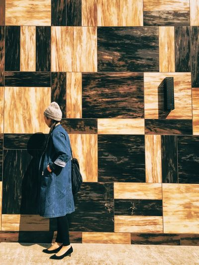 Wood - Material Rear View Full Length Real People Women Lifestyles Shot On IPhone. Built Structure Architecture Leisure Activity Standing Outdoors Day Warm Clothing Building Exterior One Woman Only Adult Adults Only People