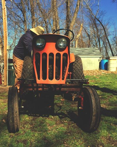 Tadaa Community Tractor Orange Color Day Field Tree Outdoors Transportation Real People One Person Nature People IPhoneography Iphone5s