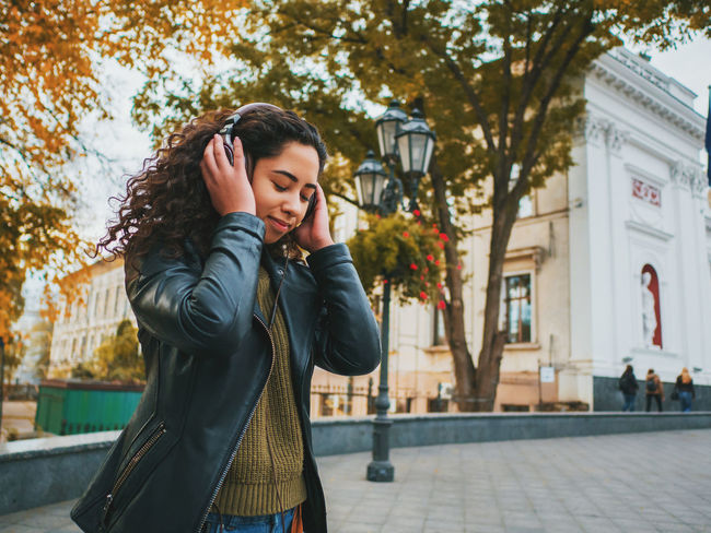 Alone Dance Dancing Earphones Headphones Latin Moving Music Nature Student Curly Hair Earpods Enjoying Life Hispanic Leisure Activity Lifestyles One Person Outdoors Park Real People Rythm Smart Phone Smiling Young Adult Young Women