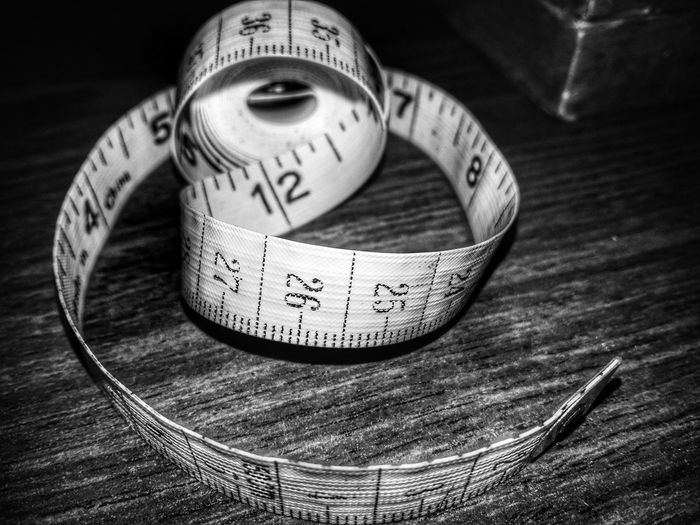 High angle view of tape measure on table