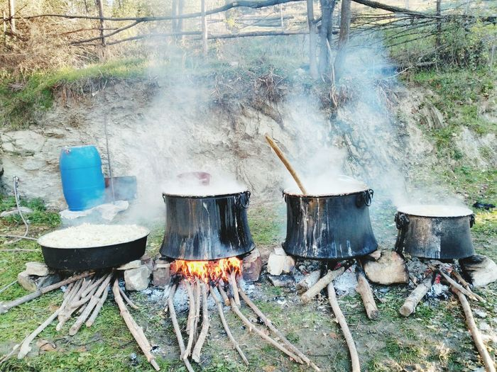 Cooking over traditional wood-fired stove