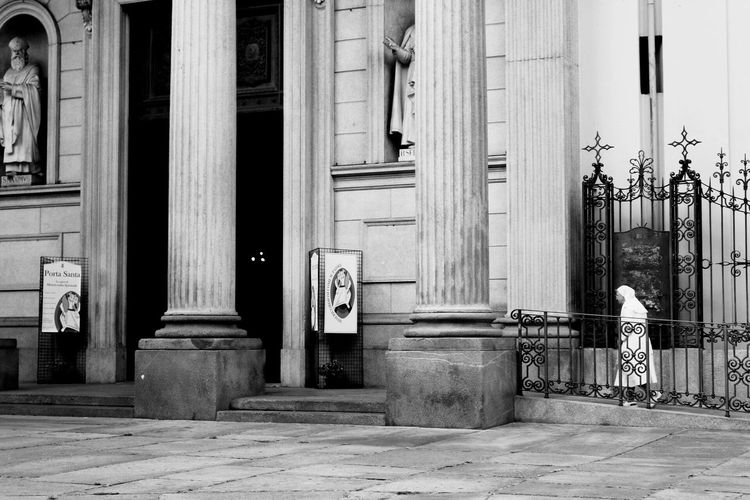 Church Architecture Built Structure Building Exterior Door Architectural Column Entrance Column City Front Door Day History Outside Entryway City Life Domestic Animals Façade Nun Blackandwhite Black And White