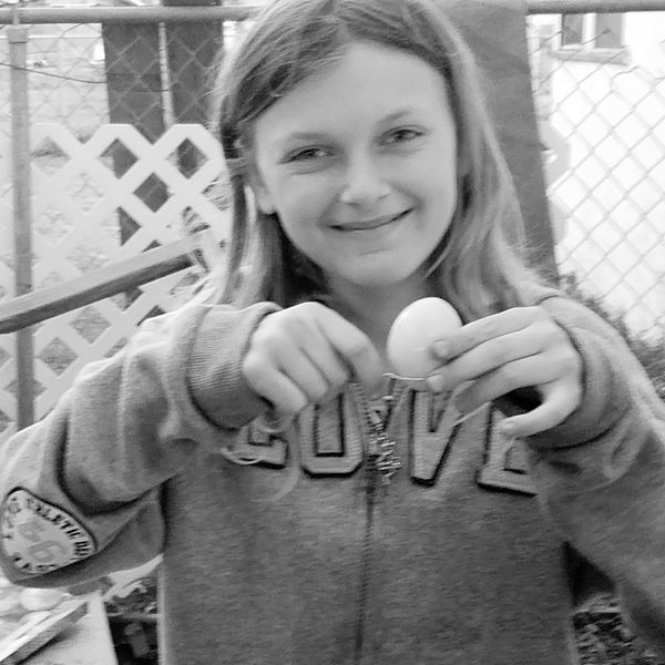 Young Girl Smiling Easter Egg Memories Happy Happiness Spring Easter Fun Dying Eggs Child With Easter Egg Tradition Egg Hunt Family Tradition Culture Holidays Side Painting Dye Spoon Backyard Activities Girl With Spoonful