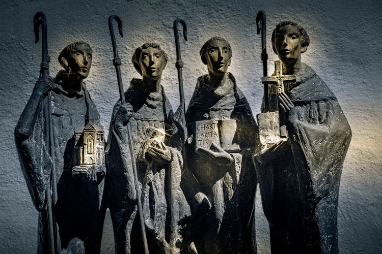Statues on wall of historic building