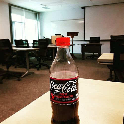 Coca Cola Coke Bottle Red Bottle Drink No People Business Finance And Industry Label Indoors  Architecture Built Structure Table Day First Eyeem Photo