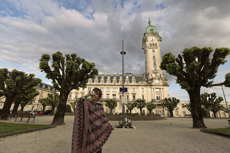 10-year-old Spanish girl in front of the Limoges station in France 10 Years Architecture France Limoges Spanish Travel Travel Photography Architecture Building Building Exterior Built Structure City Cloud - Sky Day Girl Leisure Activity Lifestyles People person Real People Sky Travel Destination Travel Destinations Tree Women