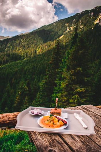 Food in plate on table against mountain