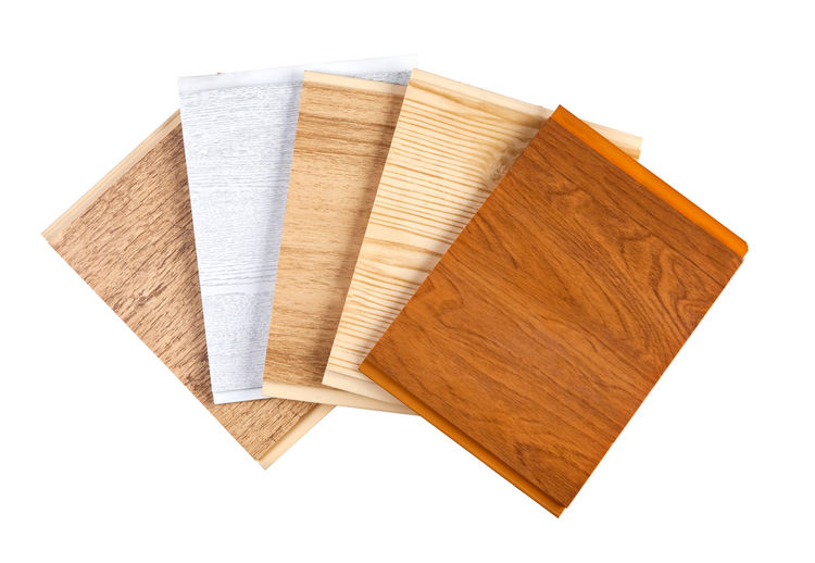 High angle view of wooden planks on white background