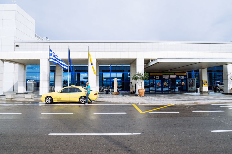 Airport Airport Terminal Architecture Arrivals Athens Airport Athens International Airport Athens, Greece Building Building Exterior Built Structure Car City City Life Departures Eleftherios Venizelos Greece Greek Flag Modern Architecture Taxi Yellow Taxi