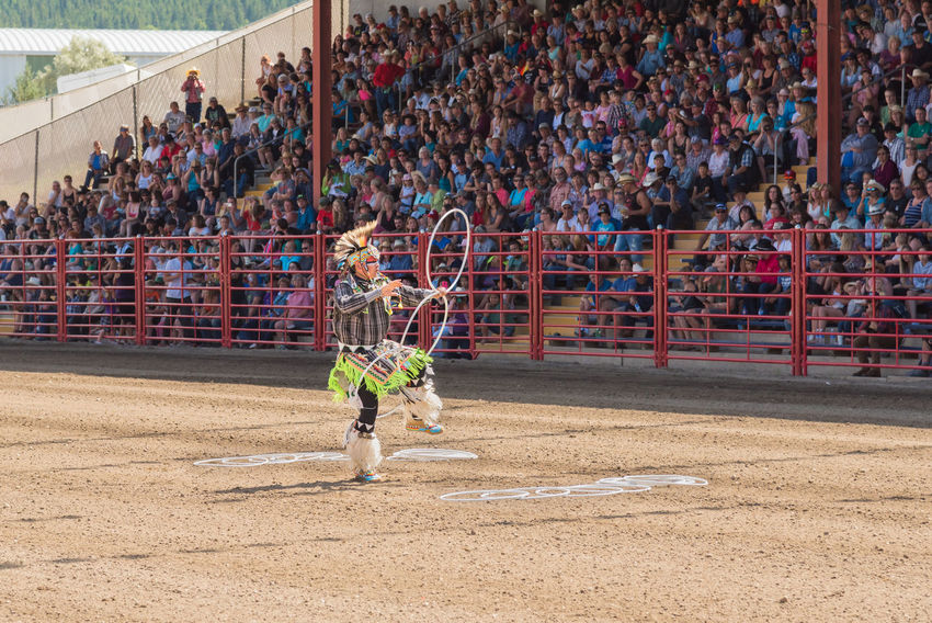 Williams Lake, British Columbia/Canada - July 2, 2016: three time world champion First Nations hoop dancer Alex Wells, performing at the internationally famous 90th Williams Lake Stampede 90th Williams Lake Stampede Alex Wells British Columbia, Canada First Nations July Performer  Rodeo Spectators Tradition Travel Audience Crowd Culture Dancer Documentary Editorial  Hoop Dance Hoop Dancing Indigenous  Stampede Stampede Grounds Stands Summer Tourism World Champion