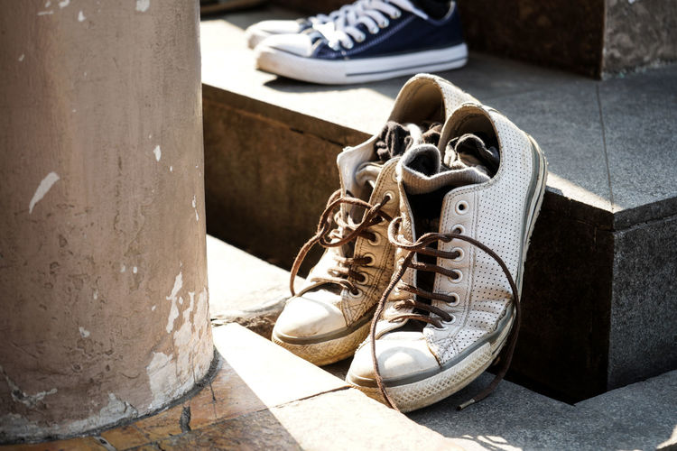 Canvas Shoe Day Flooring Focus On Foreground Footpath Leather No People Old Outdoors Pair Personal Accessory Shoe Shoelace Sole Of Shoe Sunlight