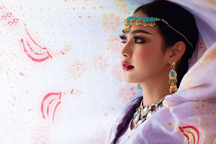 Close-up of young woman wearing sari