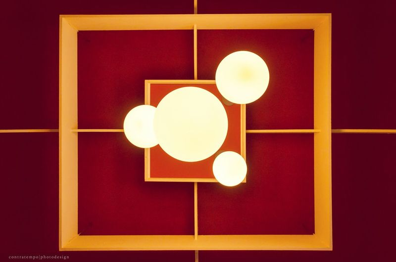Yellow lamp and orange on wall