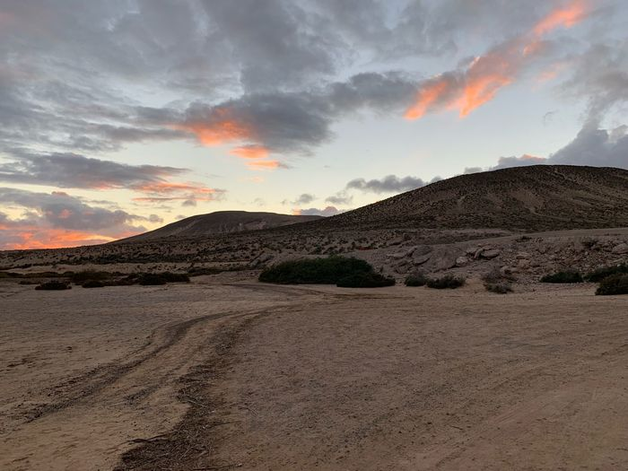 Sky Cloud - Sky Scenics - Nature Environment Beauty In Nature Sunset Landscape Outdoors Arid Climate Remote Orange Color Non-urban Scene Tranquility Desert Tranquil Scene No People Sand Land Mountain Nature