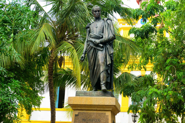 Statue of the liberator Simon Bolivar in Mompox, Colombia Architecture Bolivar Bolivar Plaza Colombia Destination Green Grove Growth Growth Jungle Liberator Magdalena Mompos Mompox  Monument Natural Nature Outdoors River SimonBolivar Summer Town Tree Tropical Waterfront