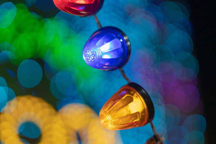 Sphere No People Hanging Close-up Multi Colored Focus On Foreground Illuminated Blue Reflection Decoration Celebration Christmas Indoors  Glass - Material Lighting Equipment Night Christmas Ornament Shape Christmas Decoration Low Angle View Nightlife