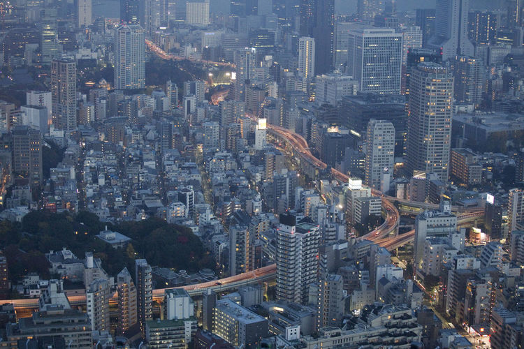 An aerial view of one of Tokyo's impressive highways. Aerial View Architecture Building Exterior City Cityscape Downtown District Highway Illuminated Modern Night No People Outdoors Skyscraper Tokyo Tower Travel Destinations Urban Skyline Mobility In Mega Cities