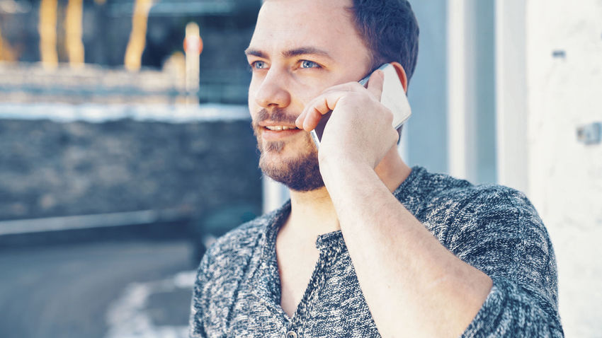 Beard Chat Chatting Close-up Day Mobile One Man Only One Person Outdoors People Phone Portrait Real People Smart Phone Speaking Standing Talking Young Adult