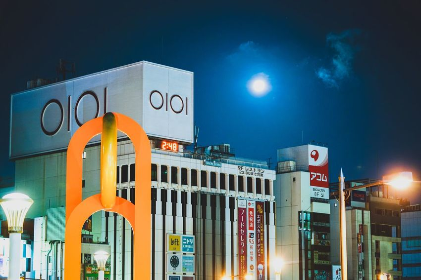moon Night Illuminated Building Exterior Architecture Built Structure Outdoors No People Blue Sky Neon Japan Discoverjapan Moonlight Sky And Clouds