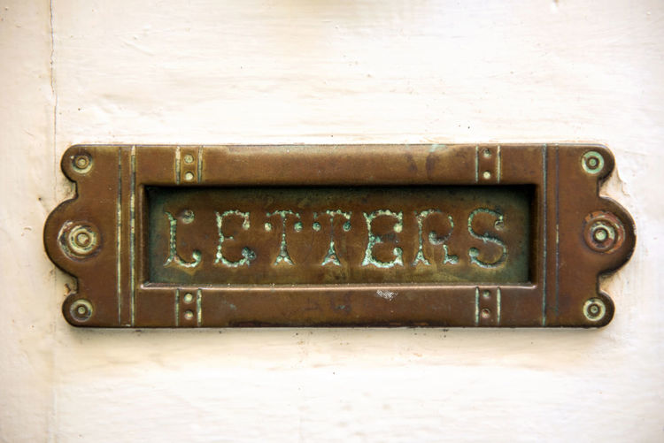 Vintage letterbox on white door in Malta Bronze Doors Home Letter Box Letters Malta Weathered Brass Brazen Close-up Detail Door Gold Colored House Letterbox Mdina Malta Metal Old Old House Old-fashioned Property Public Mailbox Rusty Valletta Vintage