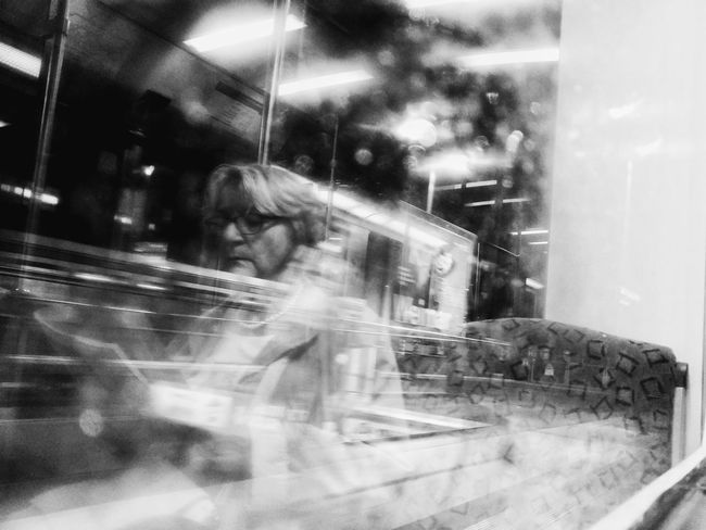Adult Window People Adults Only Reflection Night Young Adult One Person Real People City Indoors  Occupation Black And White Train Train Window Window Reflections City Lights Reading A Book Reading On The Train Old Lady Elderly Woman Berlin Street Photography Streetphoto_bw Berliner Ansichten