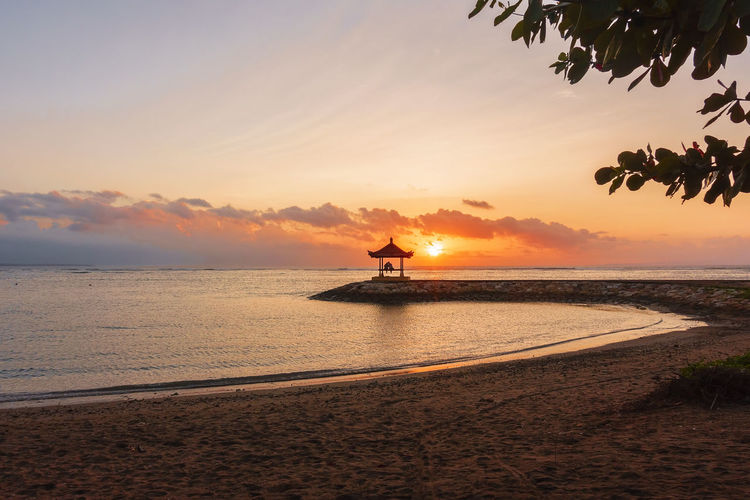 Beautiful Scenery at Karang Beach, Sanur, Bali, Indonesia Holiday Vacations Backgrounds Beach Beauty In Nature Beauty In Nature Cloud - Sky Horizon Horizon Over Water Idyllic Land Nature No People Orange Color Outdoors Scenics - Nature Sea Silhouette Sky Sunset Tranquil Scene Tranquility Travel Destinations Vacation Water