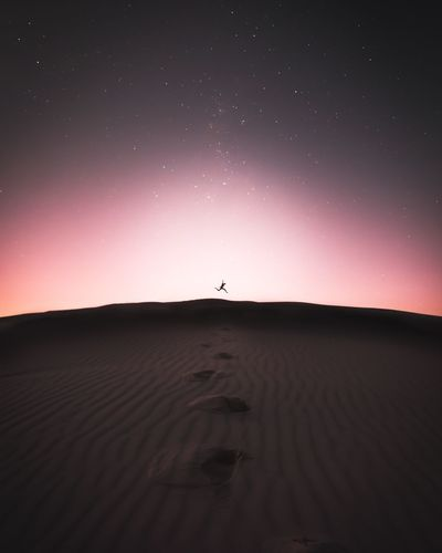 Dont take the things for granted other people are praying for.Silhouette Nature Outdoors Desert Tranquility Beauty In Nature One Person Scenics Sand Dune Astronomy Star - Space Night People Sky Sand Arid Climate Modern Travel Landscape Sunset Calm Nature Minimal Galaxy The Great Outdoors - 2018 EyeEm Awards