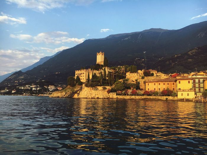 Architecture Building Exterior Built Structure Mountain Water Waterfront Mountain Range Travel Destinations Italy garda Scenics Blue Rippled Town Lake Tranquil Scene Sky River Sncient Cloud - Sky Tranquility Sea Residential District