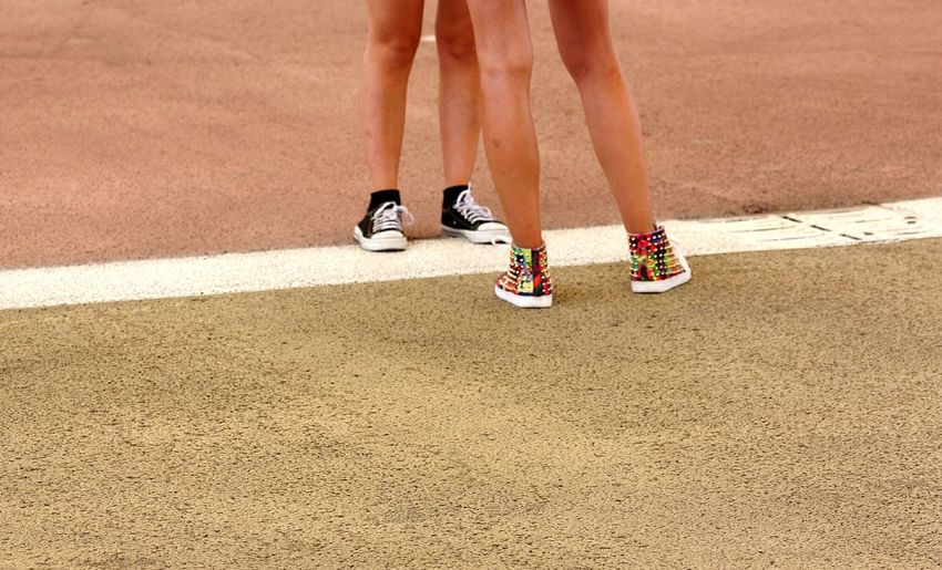Low Section Of Girls Wearing Sneakers
