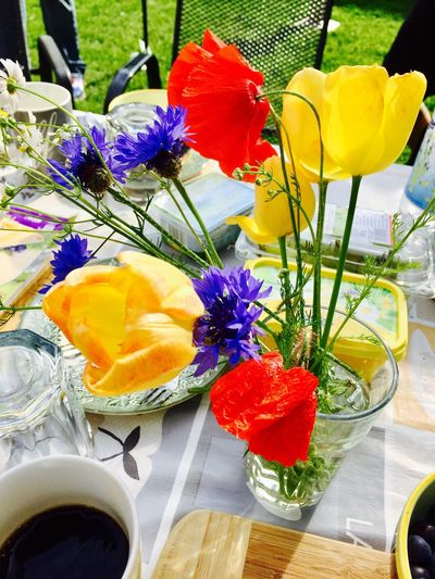 Close-up of tulips in vase on table