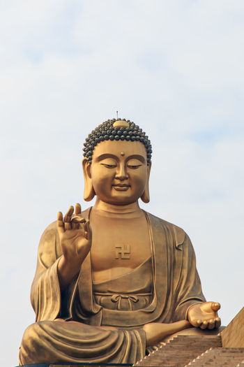 Close-Up Of Buddha Statue At Fo Guang Shan Against Sky