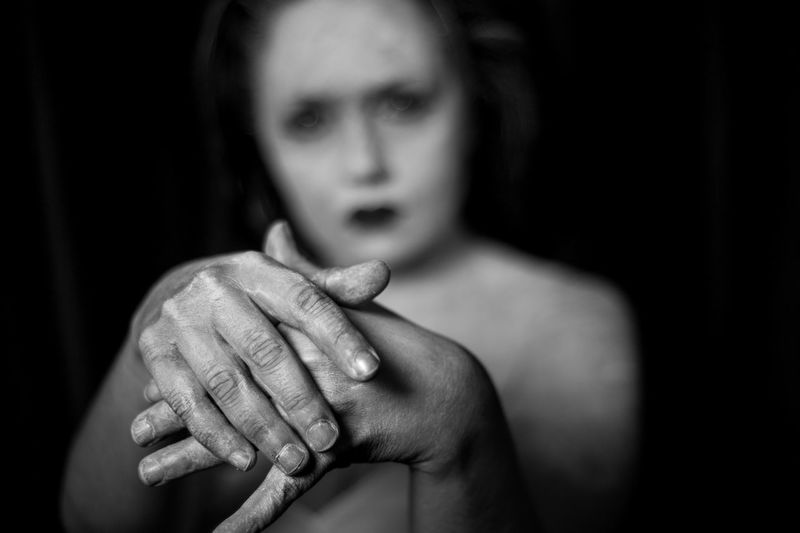 Portrait of woman with hands clasped
