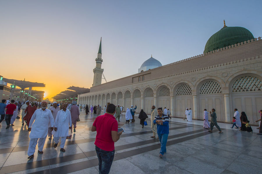 Muslims marching in front of the mosque of the Prophet Muhammad Green Dome Hajj Happiness Happy Honest Islam Islamic Islamic Architecture Muslim Pass Passion People Together Prophet Muhammad Religion Reward Sunset Sunset_collection Together Umrah