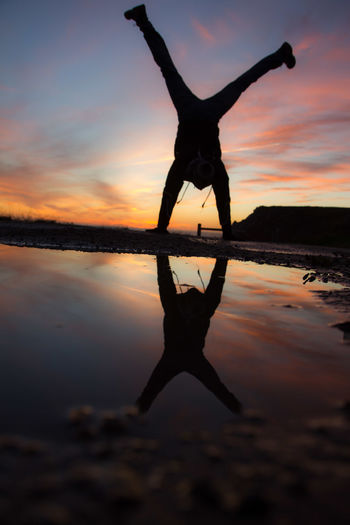 Adult Beauty In Nature Bretagne Bretagne France Handstand  Handstand ♥  Handstandeveryday Handstandseverywhere Healthy Lifestyle Men Nature One Man Only One Person Outdoors People Reflection Silhouette Sky Sunset Water