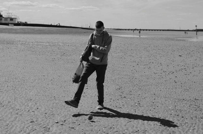 Walking Home Capture The Moment Kicking The Ball Full Length Sport Beach Sportsman Sand Child Sky