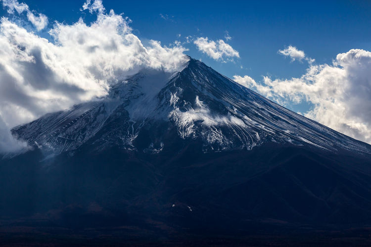 EyeEmNewHere Fujisan Japan Travel Beauty In Nature Cloud - Sky Cold Temperature Environment Landscape Mountain Mountain Peak Mountain Range Nature No People Sky Snow Snowcapped Mountain Travel Destinations Volcano Winter