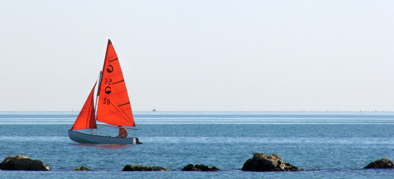 Horizontal Red Boat Clear Sky Day Horizon Over Water Outdoors Red And Blue Rocks Rocks And Water Sailboat Sailing Sailing Boat Scenics Sea Tranquility Water